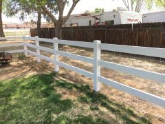 white ranch-style fence on a property