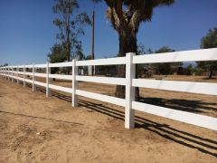 stunning white ranch-style fence beside tree