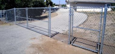 residential chain link fence with a gate