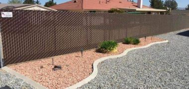 chain link privacy fence around a California home