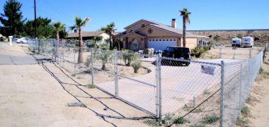 chain link fence around a high desert home