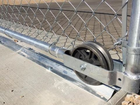 rolling gate wheel close-up photo