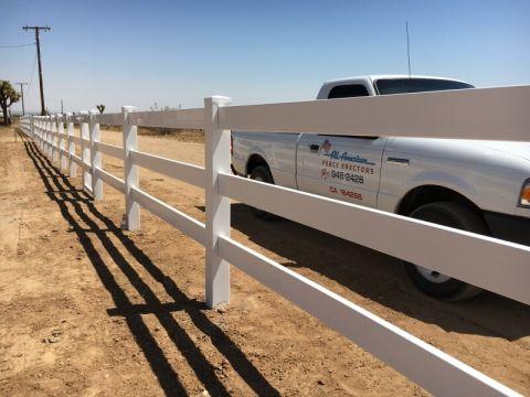 white fence near a white work truck