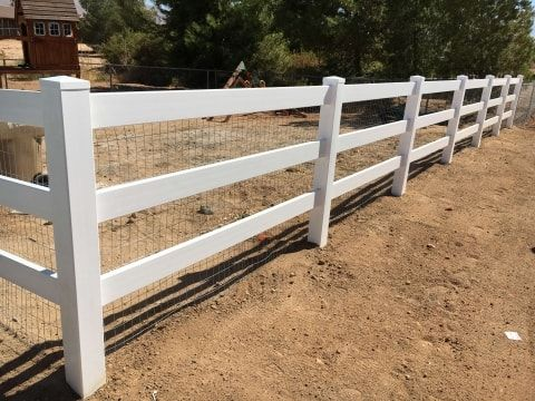 ranche style white vinyl fence with mesh