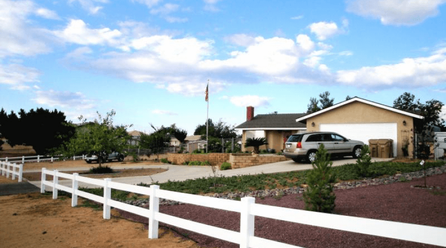 house with a newly installed ranch style fence