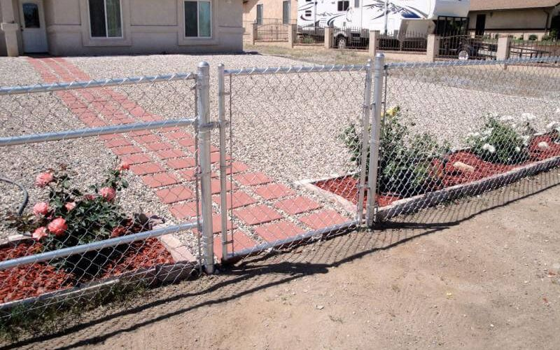 new chain link fence in front of a house) (suggested file title: new-fence