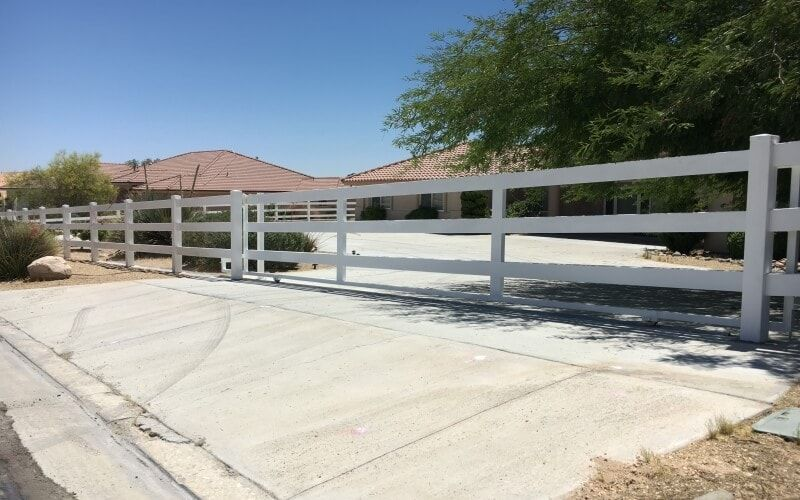 white ranch style vinyl gate