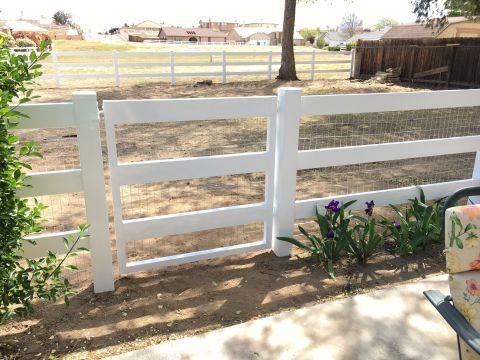 swinging vinyl ranch style gate